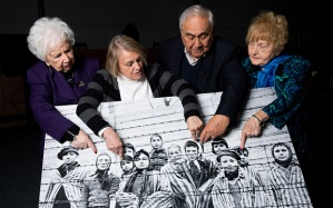 Survivors of the Auschwitz-Birkenau death camp identify themselves in a famous photo
