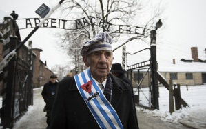 Holocaust survivor shown leaving the Auschwitz main camp which was not a death camp for Jews