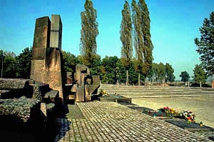 International Monument with  the ruins of one of the Auschwitz-Birkeanau gas chambers in the background