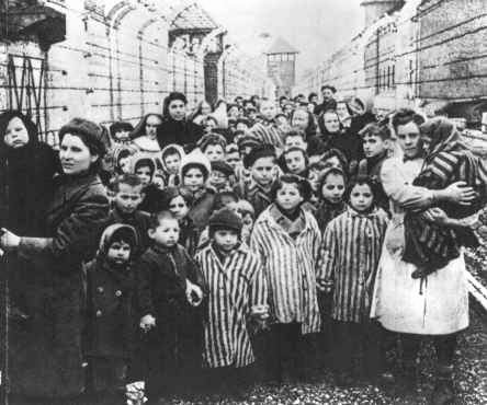 Child survivors marching out of the Birkenau death camp after it was liberated