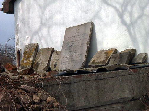 Jewish headstones stacked  against the wall of a Museum a Chelmno