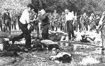 Lithuanians killing Jews as German soldiers watch