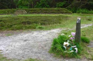 Mass grave behind the Anne Frank memorial stone