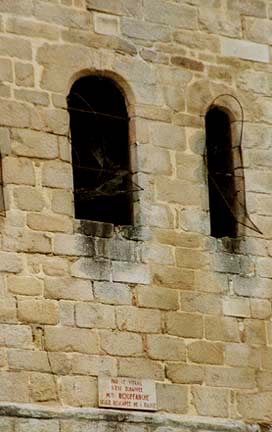 The window on the left is the middle window in the church