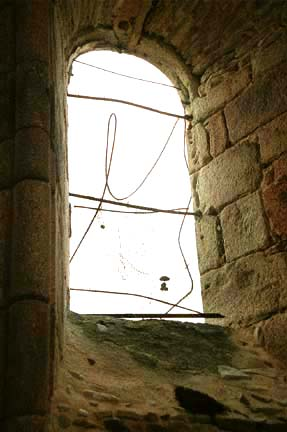 Madame Rouffanche allegedly leaped through this window behind the altar in a church