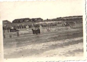 Some of the dead bodies at Bergen Belsen were buried near the German Army base, shown in the background