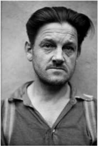 Franz Hoessler looks very unhappy in his mug shot after he was arrested by the British