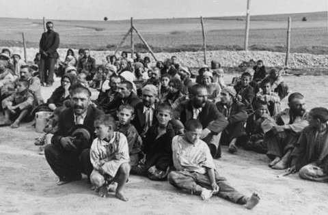 A group of Gypsies wait to be gassed at the Belzec death camp