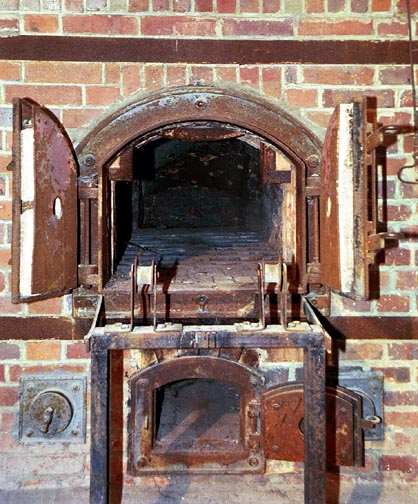 One of several ovens at Dachau where tourists can pose for a photo