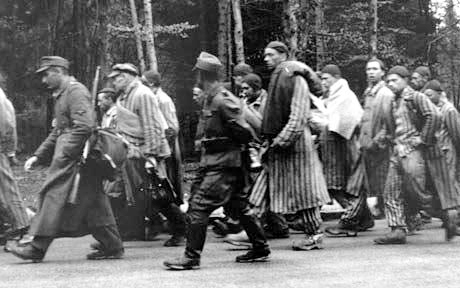 Prisoners marching out of Dachau