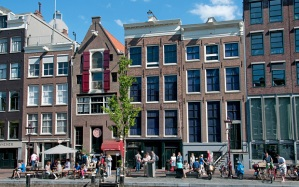 The Anne Frank house is on the left side of the house with red shutters