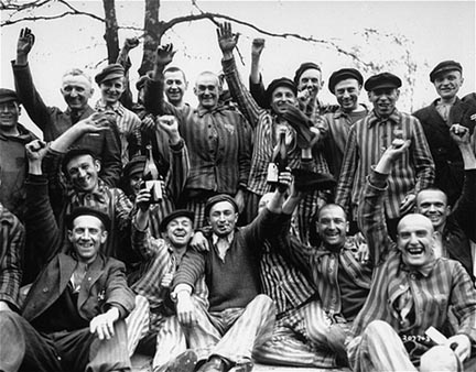 Dachau prisoners celebrate their liberation from Dachau by drinking wine