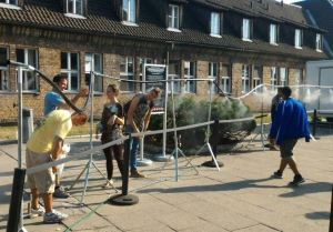Visitors to Auschwitz are sprayed with mist to help them keep cool