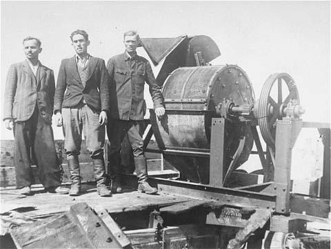 Photo from Wikipedia shows Sonderkommando Jews with a bone grinder