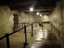 The Auschwitz gas chamber is now roped off and dark