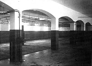 This old photo shows the shower room at Dachau which has been turned into a Museum room