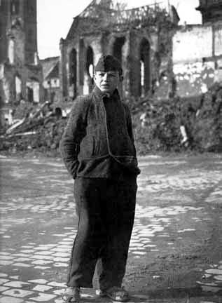 German boy looks at the bomb damage in Nuremberg, Jan. 1945