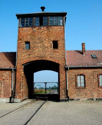 Railroad tracks entering the gatehouse at Auschwitz-Birkenau