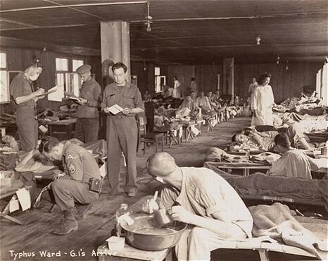 Sick prisoners in the typhus ward at Dachau