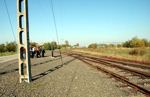 Tourists stand at the Judenrampe where the Jews got off the trains at Auschwitz