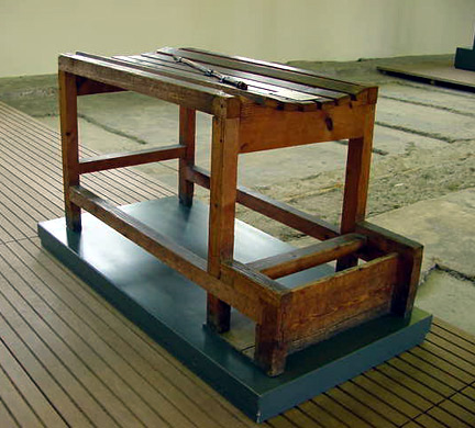 My photo of a whipping block on display at the Dachau memorial sire