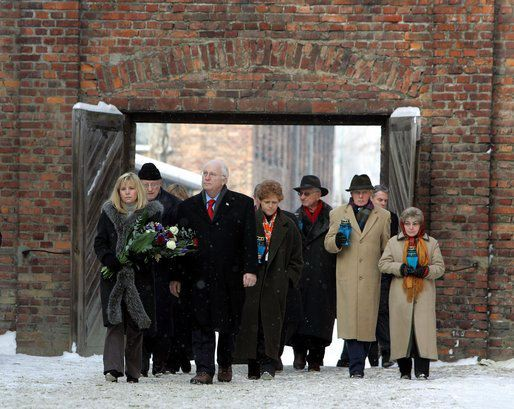 Debra Lipstadt is shown in the center of photo, next to Dick Chaney, at the Auschwitz main camp