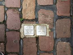 A stepping stone on a street in Berlin