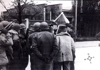 SS 2nd Lt. Heinrich Wicker surrenders camp to Brig. Gen. Henning Linden