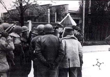 SS 2nd Lt. Heinrich Wicker surrenders camp to Brig. Gen. Henning Linden