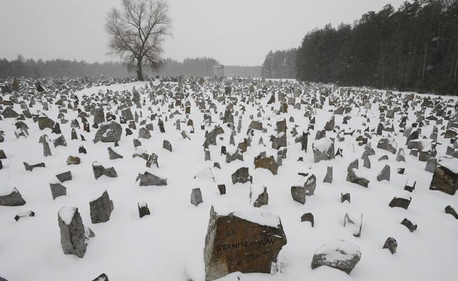 Stones with names of towns and villages, where the victims came from, are seen on the grounds of the former German Nazi Death Camp Treblinka, near the village of Treblinka, northeast Poland, Friday, Feb. 18, 2011. A German prosecutor has opened a murder investigation against a key witness in John Demjanjuk's trial on allegations the man may have been involved in mass killings at the Nazis' Treblinka concentration camp. Munich prosecutor Hans-Joachim Lutz told The Associated Press on Friday the probe is based on statements from former guards that Alex Nagorny, 94, took part in shootings at the camp in occupied Poland in 1941-42. (AP Photo/Alik Keplicz)