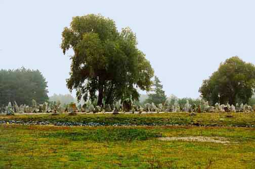 Symbolic cemetery with simulated burning pit in foreground