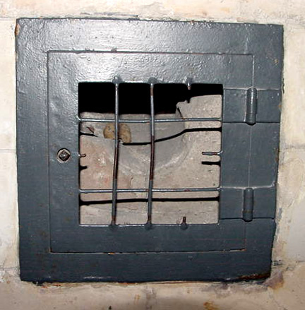 Peephole in Dachau gas chamber