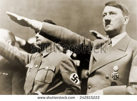 Hitler gives the Nazi salute