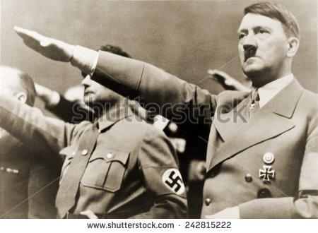Hitler gives the Nazi salute