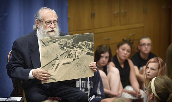 Holocaust liar claims that he is in this photo