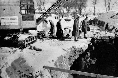 Prisoners digging a drainage ditch at Birkeanu