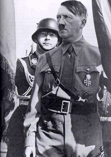 Heinrich Himmler stands behind Hitler was the first party rally