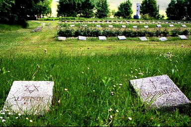 Jewish prisoner at Dachau is buried side by side with Christian victim