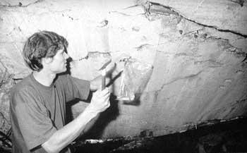 Germar Rudolf inside a gas chamber, taking samples
