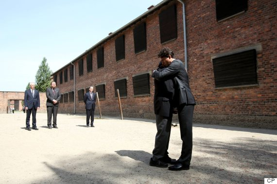 Trudeau hugs Holocaust survivor Nate Leipciger during their visit to the site of former German Nazi concentration camp. (Photo: EPA/CP)
