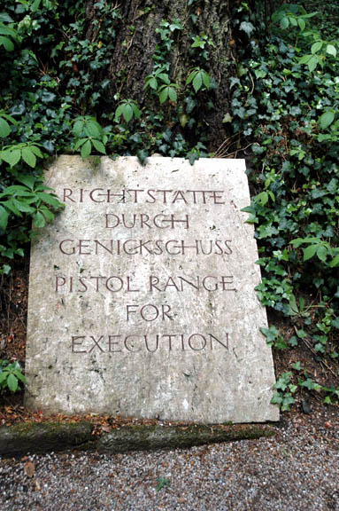 My photo of a marker at the spot where men were executed at Dachau