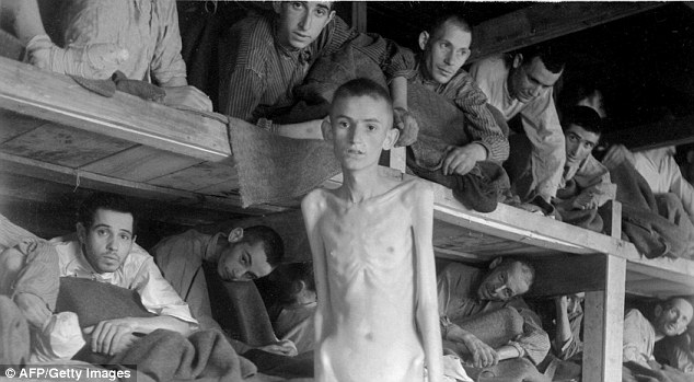 Abraham Pik poses inside a concentration camp