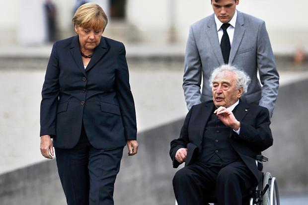 Angela Merkel walks beside Max Mannheimer