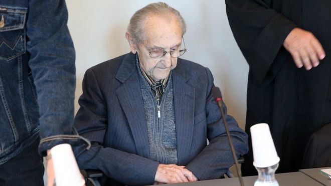 Hubert Zafke sits in a wheelchair in the courtroom