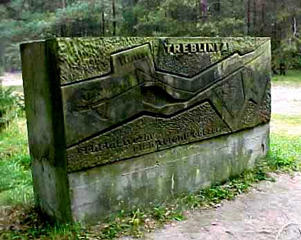 Stone with a map showing the direction to the labor camp and the death camp