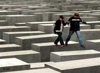 Teenagers having fun at the Holocaust Memorial in Berlin