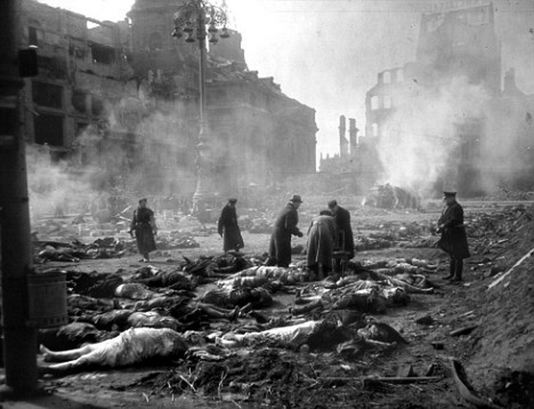 (FILES) Photo dated 25 February 1945 showing residents and emergency personnel lining up bodies to be burned at the Old Market in the east German city of Dresden, following allied bombings 13 February 1945. The 60th anniversary of the massive fire bombing of the city, which killed anywhere between 25.000 to 135.000 people, many of them refugees fleeing the Russian advance, will be commemorated in Dresden 13 February 2005, amidst calls by far-right parties to hold a mass rally in Dresden on the occasion. AFP PHOTO SLUB DEUTSCHE FOTOTHEK/WALTER HAHN (Photo credit should read WALTER HAHN/AFP/Getty Images)