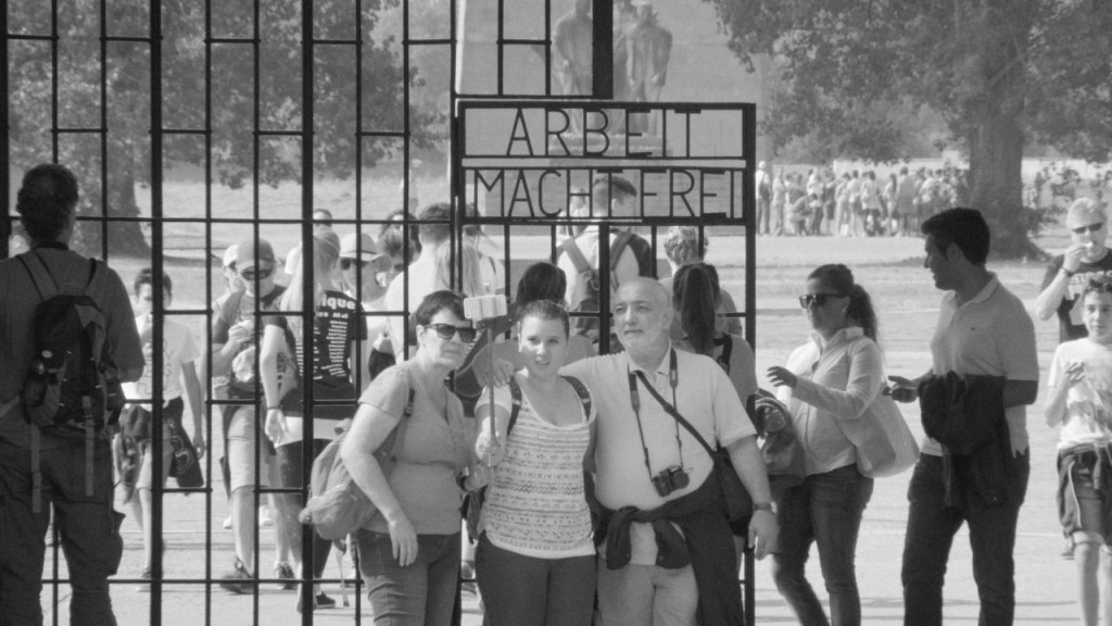 Tourists posing for photo at Sachsenhausen memorial site